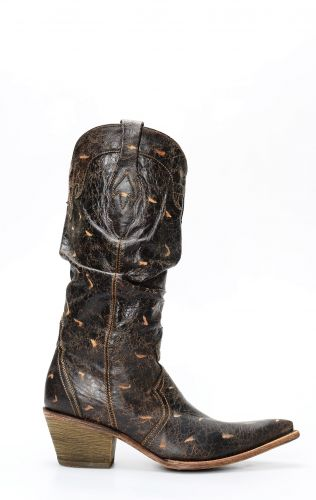 Brown Frida boots by Cuadra with folds on the leg