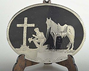 Fibbia Johnson & Held  0806 praying cowboy